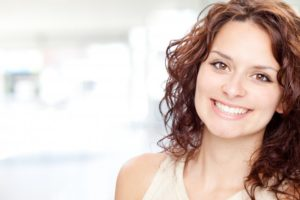 woman brown hair beautiful smile