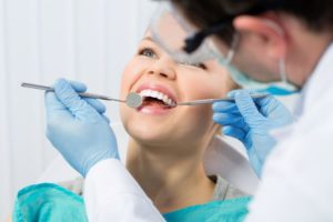 dental professional caring for patient