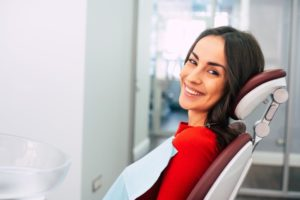 Woman smiling in her dentist's chair